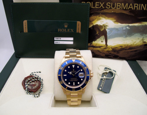 ROLEX Submariner Date Tout or jaune 18K -